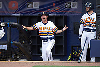 Canisius College Golden Griffins head coach Mike McRae (21) argues a call with the umpire as Nick Capitano (35) looks on during the second game of a doubleheader against the Michigan Wolverines on February 20, 2016 at Tradition Field in St. Lucie, Florida.  Michigan defeated Canisius 3-0.  (Mike Janes/Four Seam Images)
