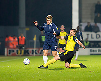 3rd December 2019; Pirelli Stadium, Burton Upon Trent, Staffordshire, England; English League One Football, Burton Albion versus Southend United; Jake Buxton of Burton Albion comes in for a sliding tackle on Stephen Humphrys of Southend United to kick the ball out of play - Strictly Editorial Use Only. No use with unauthorized audio, video, data, fixture lists, club/league logos or 'live' services. Online in-match use limited to 120 images, no video emulation. No use in betting, games or single club/league/player publications
