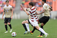 Houston, TX - Friday December 11, 2016: Luis Argudo (2) of the Wake Forest Demon Deacons and Foster Langsdorf (2) of the Stanford Cardinal chase after a loose ball at the NCAA Men's Soccer Finals at BBVA Compass Stadium in Houston Texas.
