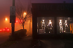 Mannequins in window of an adult lingerie and video store, early morning in fog