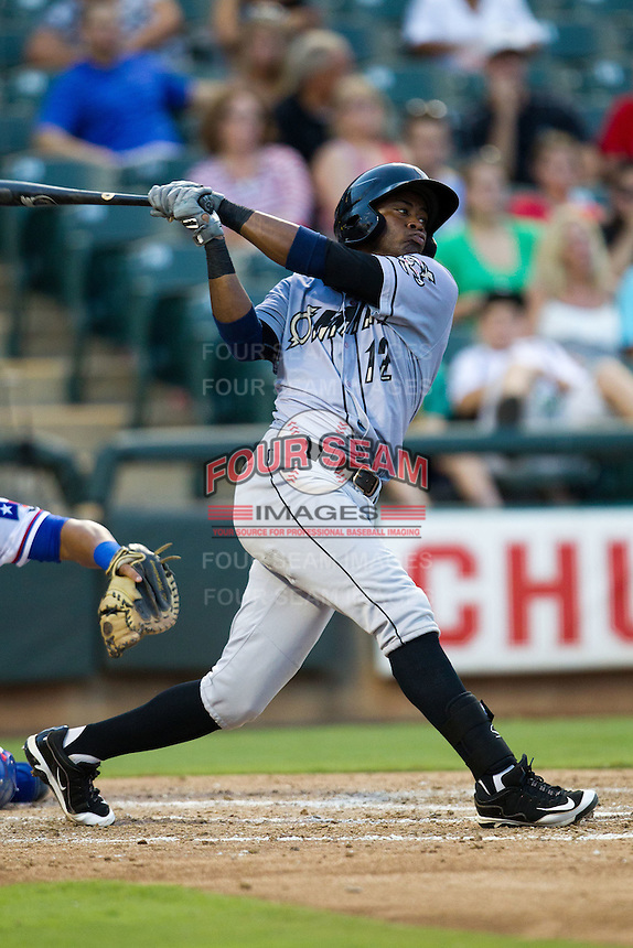 Omaha Storm Chasers shortstop Irving Falu #12 swings during the Pacific Coast League baseball game against the Round Rock Express on July 22, 2012 at the Dell Diamond in Round Rock, Texas. The Express defeated the Chasers 8-7 in 11 innings. (Andrew Woolley/Four Seam Images).