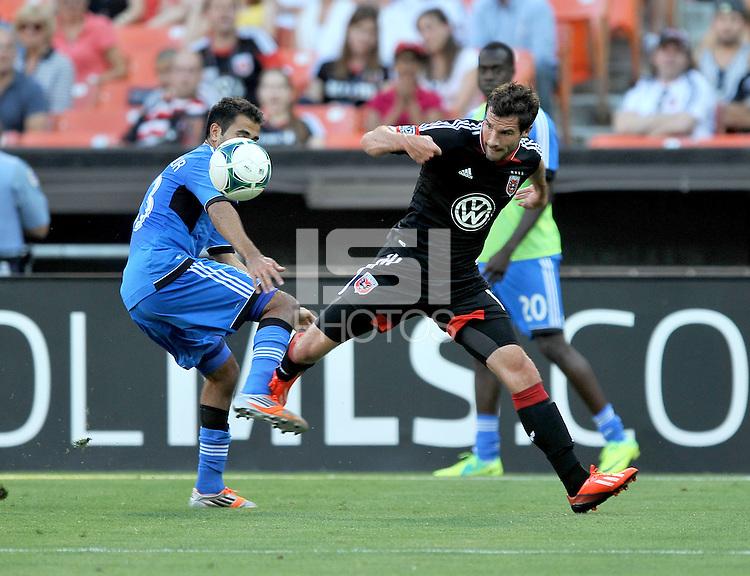 Chris Pontius (13) of D.C. United goes against Steven Beitashour (33) of the San Jose Earthquakes.  D.C. United defeated the San Jose Earthquakes 1-0, at RFK Stadium, Saturday June 22 , 2013.
