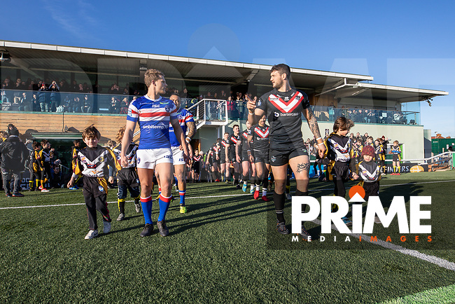 Teams enter the pitch for the Betfred Super League match between London Broncos and Wakefield Trinity at Castle Bar , West Ealing , England on 3 February 2019. Photo by David Horn.