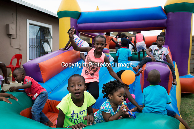 SOWETO, SOUTH AFRICA FEBRUARY 1: A child's birthday party celebration at a house on February 1, 2014 in Meadowlands section, Soweto, South Africa. Soweto is a mix of old housing and newly constructed townhouses and upmarket areas such as Diepkloof. The population in Soweto is estimated to be around one million people. A new hungry black middle-class is growing steadily. Many residents work in Johannesburg but the last years many shopping malls have been built, and people are starting to spend their money in Soweto. (Photo by: Per-Anders Pettersson)