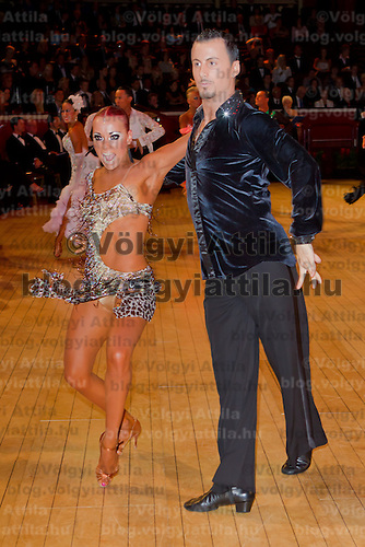 Manuel Frighetto and Karin Rooba from Estonia perform their dance during the latin-american competition of the International Championships held in Royal Albert Hall, London, United Kingdom. Thursday, 13. October 2011. ATTILA VOLGYI