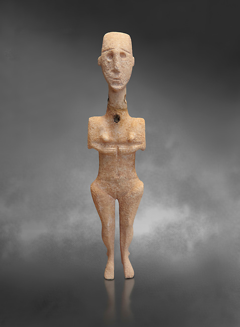 Cycladic statue figurine of the naturalistic 'Plastira' type of Paros. Early Cycladic Period I (Grotta-Pelos Phase 3200-2800 BC). National Archaeological Museum, Athens.   Gray background.<br /> <br /> <br /> This type of Cycladic figurine stand with feet lat to the ground with detailed facial features and ears to make a more realistic statue.