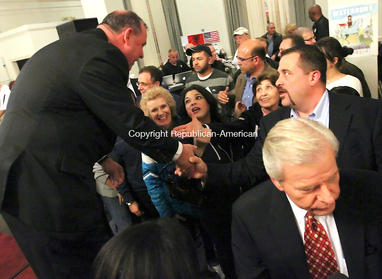 Waterbury, CT-08 November 2011-110811CM14- Waterbury's mayor-elect Neil O'Leary is congratulated by supporters at his campaign headquarters in Waterbury Tuesday night.   Christopher Massa Republican-American