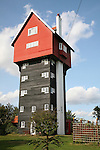 The House in the Clouds, water tower disguised as a house now used as a holiday home, Thorpeness, Suffolk, England