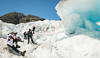 Photographing blue ice cave on Fox Glacier, Westland Tai Poutini National Park, West Coast, UNESCO World Heritage Area, New Zealand, NZ