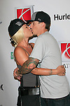 Pink with husband Carey Hart poses for photographers as Saturn kicks off X Games 12 with a party in Hollywood, California on August 2, 2006. Photo by Nina Prommer/Milestone Photo