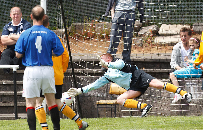 Defender turned goalie Peter Jordan can't keep out Meadow's John Paul McKeever's shot for 4-0