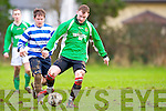 Stephen McCarthy Castleisland goes past John Kelly QPR during their league clash in Castleisland on Sunday