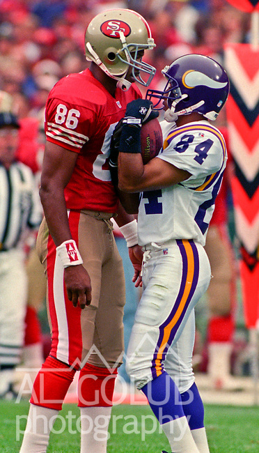 San Francisco 49ers vs. Minnesota Vikings at Candlestick Park Sunday, October 3, 1993.  49ers beat Vikings 38-19.  San Francisco 49ers wide receiver Odessa Turner (86) and Minnesota Vikings wide receiver Eric Guliford (84) had discussion over ball.