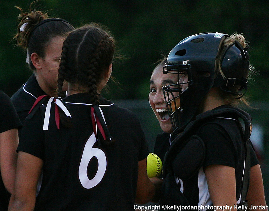 Navarre pitcher Jessica Apodaca, (14), right, celebrates with her teammates after a strike out during their game against Middleburg, in Middleburg, Florida Friday night, April 27, 2007.(Kelly Jordan)
