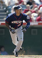 Torii Hunter of the Minnesota Twins runs to first base during a 2002 MLB season game against the Los Angeles Angels at Angel Stadium, in Anaheim, California. (Larry Goren/Four Seam Images)