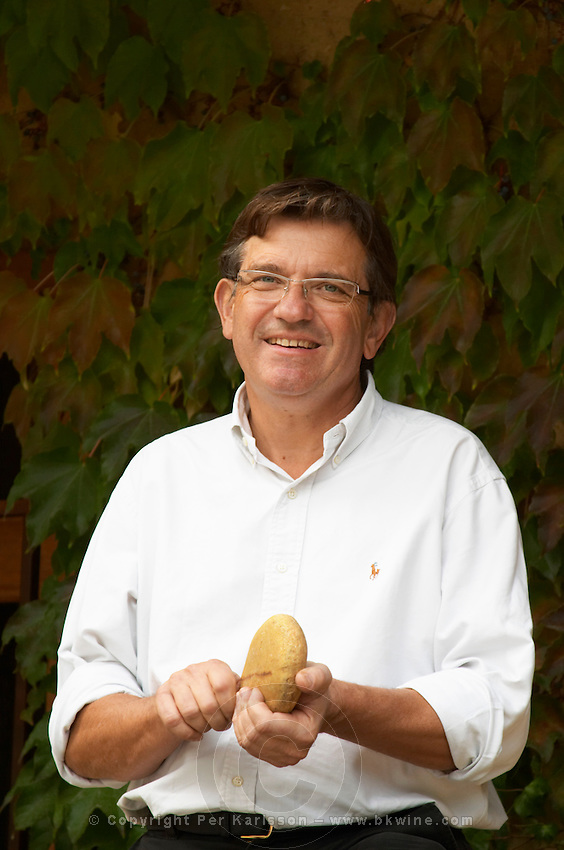 Francois Perrin, one of the Perrin brothers of Chateau de Beaucastel holding one of the typical stones of Chateauneuf, called galet in French  Chateau de Beaucastel, Domaines Perrin, Courthézon Courthezon Vaucluse France Europe