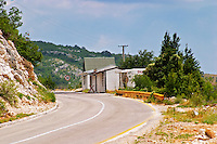 The border crossing between Montenegro and Bosnia-Herzegovina. Border control checkpoints and a shop for duty free in a small hut along the road. Trebinje region. Republika Srpska. Bosnia Herzegovina, Europe.