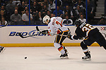 Calgary Flames defenseman T.J. Brodie (7) is pressured by St. Louis Blues center Chris Porter (32) in the third period during a game between the Calgary Flames and the St. Louis Blues on Thursday April 25, 2013 at the Scottrade Center in downtown St. Louis.