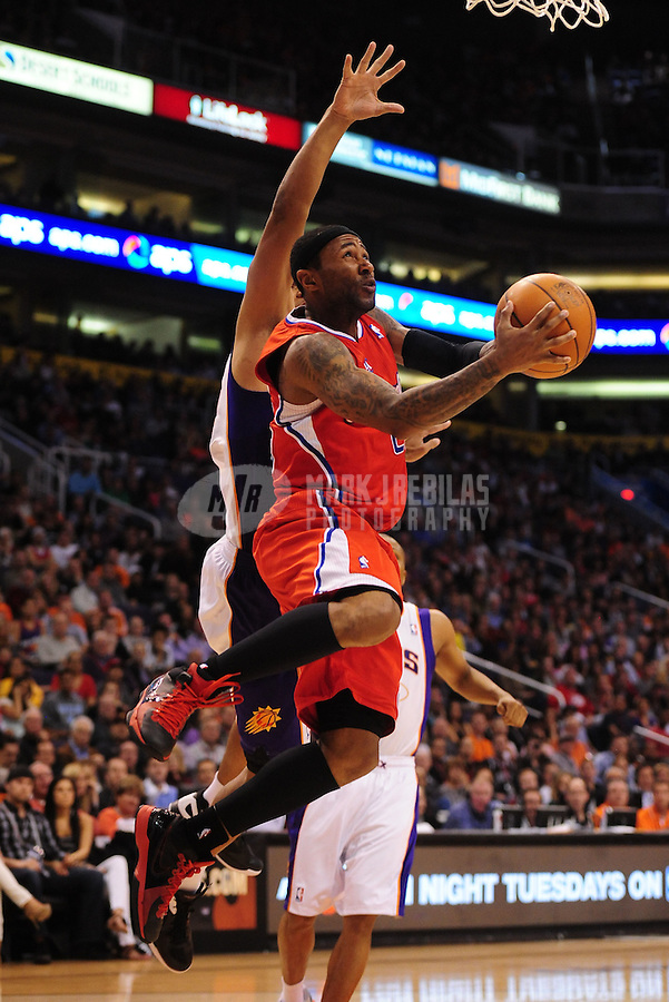 Mar. 2, 2012; Phoenix, AZ, USA; Los Angeles Clippers guard Mo Williams takes a shot under pressure during game against the Phoenix Suns at the US Airways Center. The Suns defeated the Clippers 81-78. Mandatory Credit: Mark J. Rebilas-USA TODAY Sports