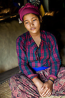 Tulasa Khadka, 14, who got married when she was 13 and gave birth to a stillborn baby weighing less than 1kg a week ago, rests at home in the remote village of Dungi Khola, near Chhinchu, Surkhet district, Western Nepal, on 1st July 2012. Tulasa eloped one year ago and didn't use contraceptives. She walks through the hills to the nearest hospital and she went into labour while on her way there for a checkup at almost full term. In Surkhet, Save the Children partners with Safer Society, a local NGO which advocates for child rights and against child marriage. Photo by Suzanne Lee for Save The Children UK