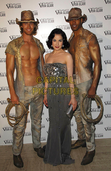 DITA VON TEESE & COWBOYS.MAC Viva Glam party at the Bloomsbury Ballroom, London, England..June 27th, 2007.M.A.C. full length grey gray strapless dress chests topless lasso rope jeans denim gold shirt hat drress up costume  lipstick silver jewel encrusted clutch purse.CAP/CAS.©Bob Cass/Capital Pictures