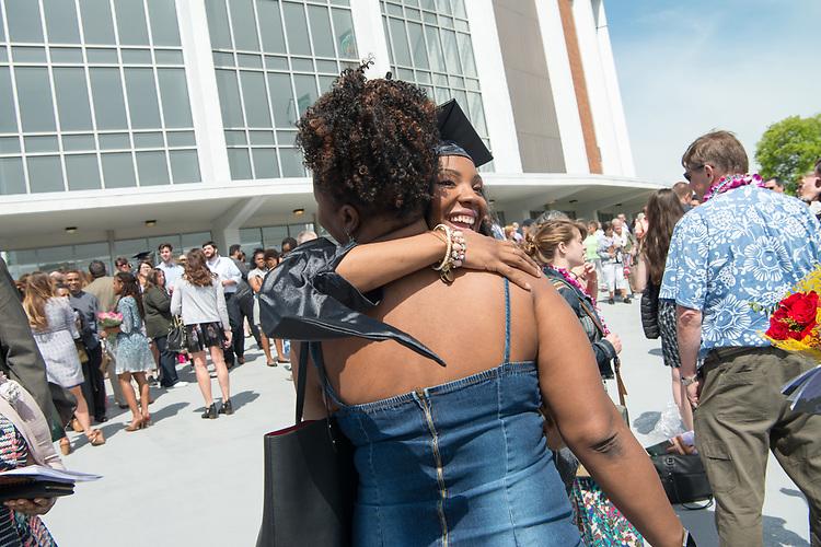 Jasche Harris hugs her mother following Graduet Commencement Ceremonies. Photo by Ben Siegel