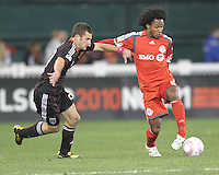 Stephen King #20 of D.C. United holds off Julian de Guzman #6 of Toronto FC during an MLS match that was the final appearance of D.C. United's Jaime Moreno at RFK Stadium, in Washington D.C. on October 23, 2010. Toronto won 3-2.