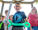 Colton McGee of Indianola sports his new balloon sward made by Tom Terrific The Balloon Man at the Warren County Fair.