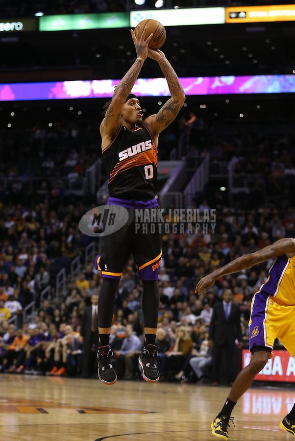 Jan. 30, 2013; Phoenix, AZ, USA: Phoenix Suns forward Michael Beasley (0) against the Los Angeles Lakers at the US Airways Center. Mandatory Credit: Mark J. Rebilas-