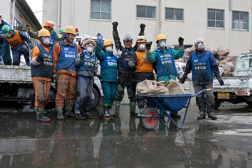 Peace boat volunteers celebrate the end of their mission after taking part in the clean-up operations in Ishinomaki, Miyagi Friday May 6th 2011. Around 350 volunteers took part in the relief effort over the Golden Week holiday, including 41 foreigners, clearing mud and removing debris from this coastal town which more almost levelled in the March 11th earthquake and tsunami.