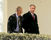 Washington, D.C. - February 28, 2006 -- United States President George W. Bush walks along the Colonnade from the Oval Office to the residence of the White House with Karl Rove, his senior advisor, chief political strategist, and Deputy White House Chief of Staff in charge of policy on February 28, 2006.  The President left the White House a few minutes later aboard Marine 1 for his 5 day trip to India and Pakistan..Credit: Ron Sachs / CNP