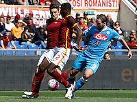 Calcio, Serie A: Roma vs Napoli. Roma, stadio Olimpico, 25 aprile 2016.<br /> Napoli&rsquo;s Gonzalo Higuain, right, is challenged by Roma&rsquo;s Ervin Zukanovic, left, and Antonio Ruediger during the Italian Serie A football match between Roma and Napoli at Rome's Olympic stadium, 25 April 2016.<br /> UPDATE IMAGES PRESS/Riccardo De Luca