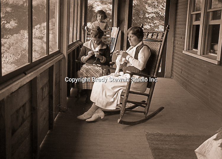 North East PA: Aunt Helen and Sarah Stewart knitting on the porch during a rainy day at the lake - 1919.  Little Helen watching mom and Aunt Helen.  This was the Stewart family's first Lake Erie vacation after Brady Stewart served his country during World War 1.  Stewart family rented a cabin on Lake Erie near North East.