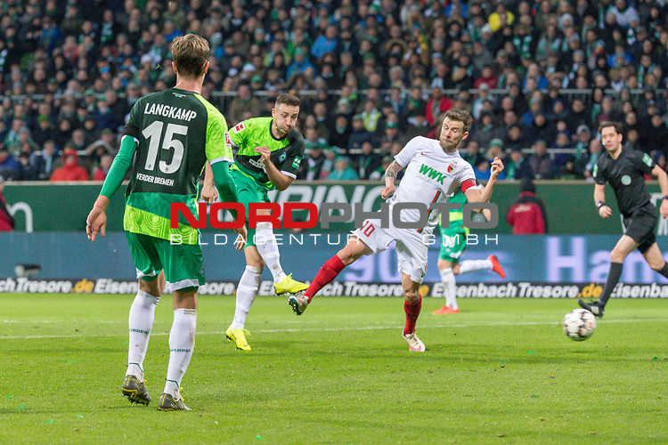 10.02.2019, Weser Stadion, Bremen, GER, 1.FBL, Werder Bremen vs FC Augsburg, <br /> <br /> DFL REGULATIONS PROHIBIT ANY USE OF PHOTOGRAPHS AS IMAGE SEQUENCES AND/OR QUASI-VIDEO.<br /> <br />  im Bild<br /> <br /> Kevin Möhwald / Moehwald (Werder Bremen #06) zum 4:0 tor <br /> Daniel Baier (FC Augsburg #10)<br /> Sebastian Langkamp (Werder Bremen #15)<br /> r<br /> <br /> Foto © nordphoto / Kokenge