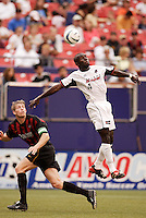 The MetroStars' John Wolyniec watches the Burn's Chris Gbandi go up for a header. The Dallas Burn defeated the MetroStars 1-0 at Giant's Stadium, East Rutherford, NJ, on August 15, 2004.