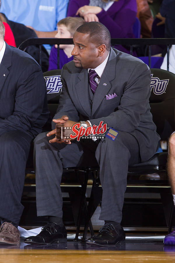 High Point Panthers assistant coach Ahmad Dorsett watches from the sideline during second half action against the Wofford Terriers at Millis Athletic Center on November 24, 2013 in High Point, North Carolina.  The Panthers defeated the Terriers 66-56.   (Brian Westerholt/Sports On Film)
