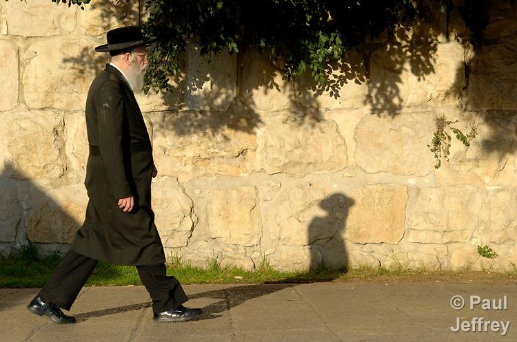 An orthodox Jew walks near the old city in Jerusalem.