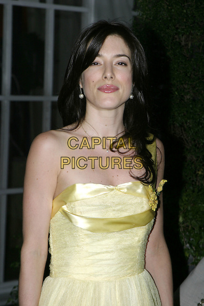 JAIME MURRAY & GUEST.At the Berkeley Square Ball, Berkeley Square, .London, July 19th 2005..half length jamie yellow strapless prom dress satin ribbon.Ref: AH.www.capitalpictures.com.sales@capitalpictures.com.©Adam Houghton/Capital Pictures.