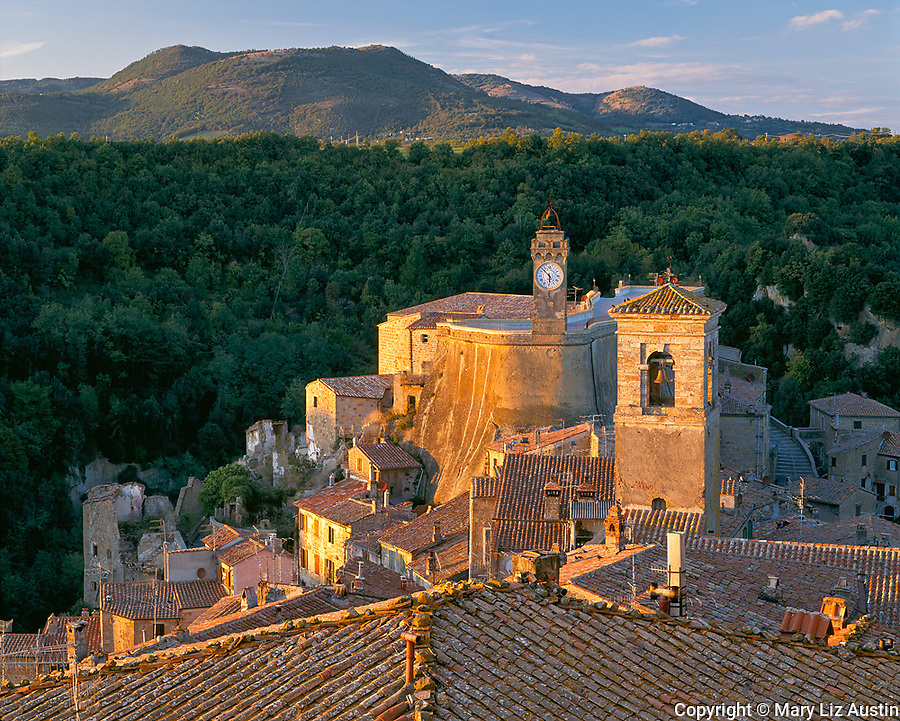Tuscany, Italy<br /> Bell tower above the terraced buildings and tiled roofs of Sorano, a hill town in southern Tuscany