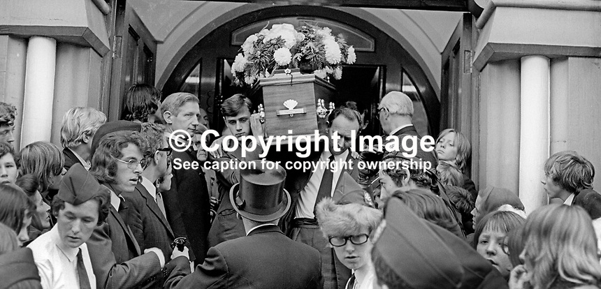 Funeral of missing Belfast, N Ireland, schoolboy, Brian McDermott, whose body was found a week after he went missing between school and home on 2nd September 1973. His coffin is carried from Mountpottinger Presbyterian Church. 197309120582b<br />