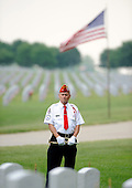 Ta bugler waits to play taps as United States President Barrack Obama places a wreath at Abraham Lincoln National Cemetery in Elwood, Illinois on Memorial Day, Monday, May 31, 2010.    .Credit: David Banks / Pool via CNP