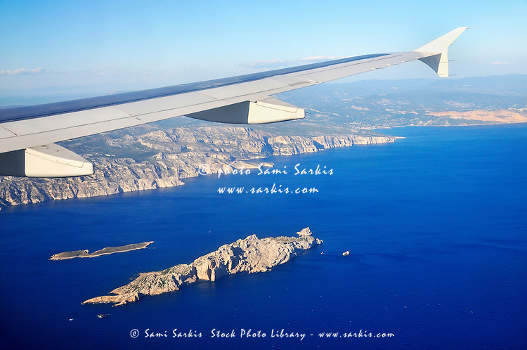 Airplane flying over Calanques and Riou Island, Marseille, France, (aerial view)