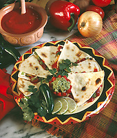 Quesadilla on Festive Plate with hot pepper and guacamole