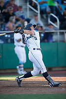 Everett AquaSox catcher Troy Dixon (34) follows through on his swing during a Northwest League game against the Tri-City Dust Devils at Everett Memorial Stadium on September 3, 2018 in Everett, Washington. The Everett AquaSox defeated the Tri-City Dust Devils by a score of 8-3. (Zachary Lucy/Four Seam Images)