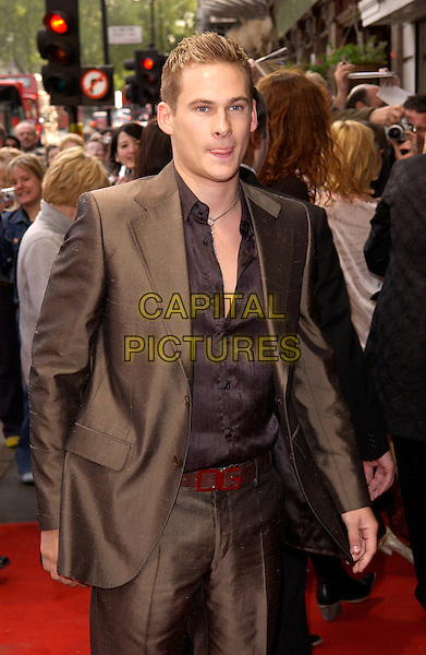 LEE RYAN.Attends the opening night and World Premiere of Billy Elliot the Musical, at the Victoria Palace Theatre, London, May 12th 2005..half length brown suit funny tongue.Ref: DH.www.capitalpictures.com.sales@capitalpictures.com.©David Hitchens/Capital Pictures.