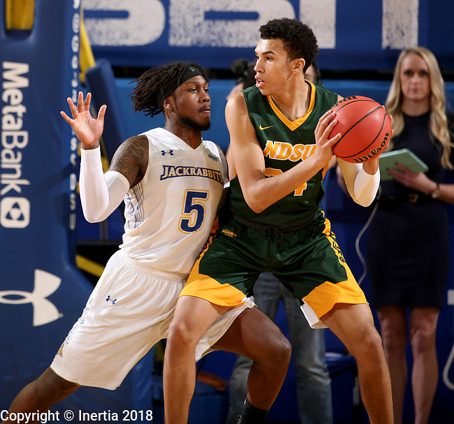 BROOKINGS, SD - FEBRUARY 1: David Jenkins Jr. #5 from South Dakota State University defends against Tyson Ward #24 from North Dakota State University during their game Thursday at Frost Arena in Brookings. (Photo by Dave Eggen/Inertia)