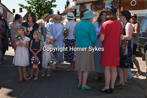 """Stowey Female Friendly Society Club Day. The Womens Walk Day. Local women and flower girls meet at the village """"cross"""". Nether Stowey Somerset UK. 2014. 208th"""