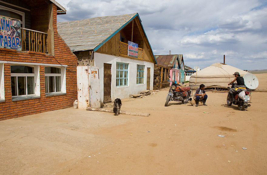 Sitting on a goat. Roadside stop 100km west of Ulaan Baatar. Mongolia.
