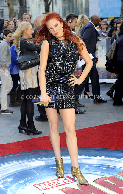 WWW.ACEPIXS.COM....US Sales Only....April 18 2013, London....Carmit Bachar at the premiere of 'Iron Man 3' held at the Odeon Leicester Square on April 18 2013 in London ....By Line: Famous/ACE Pictures......ACE Pictures, Inc...tel: 646 769 0430..Email: info@acepixs.com..www.acepixs.com