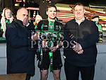 Dundalk Young Irelands captain Cian O'Nairaigh is presented with the trophy from Pat Lynagh treasurer of Leinster GAA and Martin O'Halloran PRO of Leinster GAA after they beat St Brigid's in the Leinster JFC. Photo:Colin Bell/pressphotos.ie
